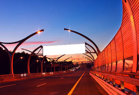 night highway: White empty billboard on night highway