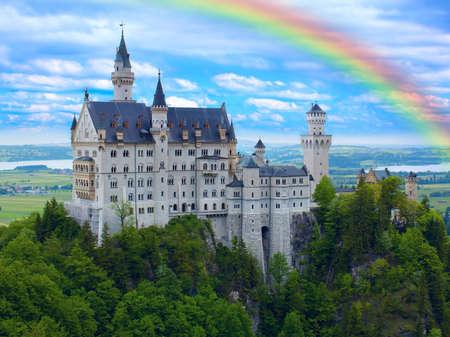 Rainbow over castle Neuschwanstein in Bavarian Alps Editorial