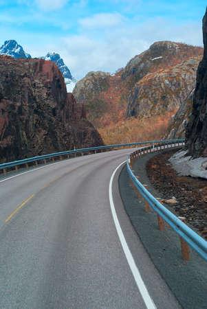 Grey road in mountains of Lofoten in Norway
