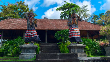 Statues of the gods at the entrance to a temple in Bali, Indonesia Stock Photo