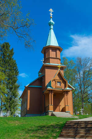 Wooden rural Orthodox church in the spring sunny day Stock Photo