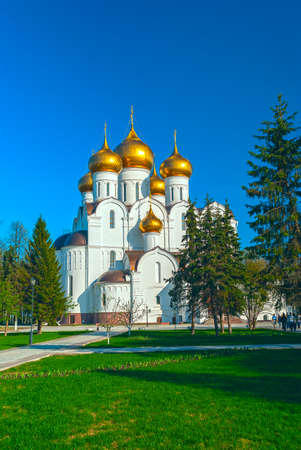 Ancient ortodox christian curch with golden domes in sunny spring day
