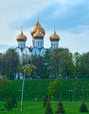 Ancient ortodox christian curch with golden domes in cloudy day Stock Photo