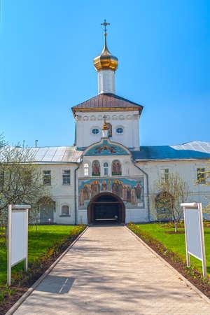 Entrance gate to white orthodox monastery Stock Photo