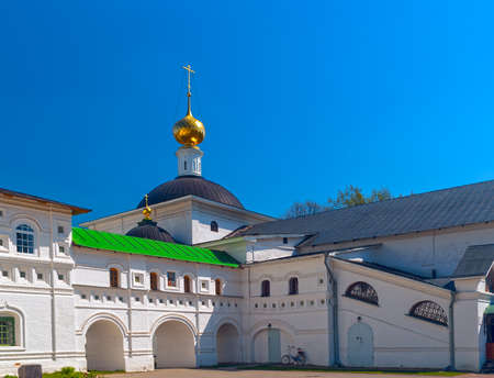 green cross: Courtyard white orthodox monastery with bicycle Stock Photo