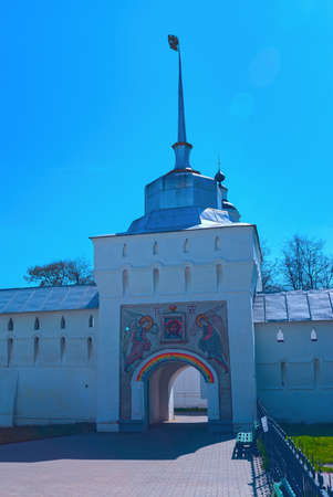Entrance gate to the white orthodox monastery with the icon of Christ and the angels
