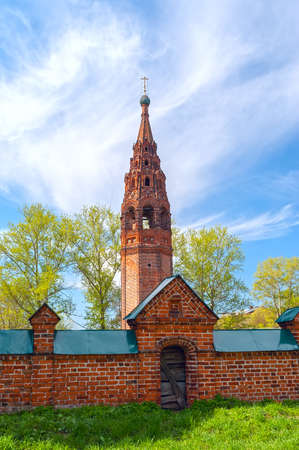 Repairing church of red brick in summer sunny day