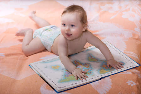 Toddler with books of the world maps