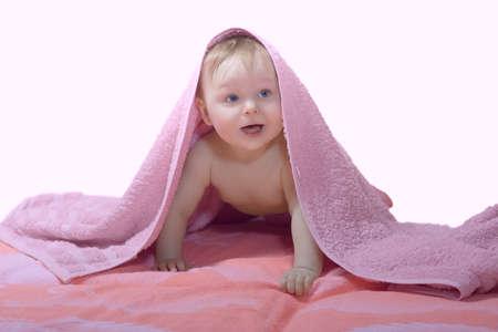 Baby under pink towel