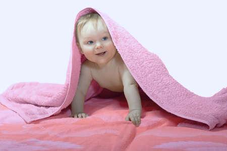 Little kid under pink towel