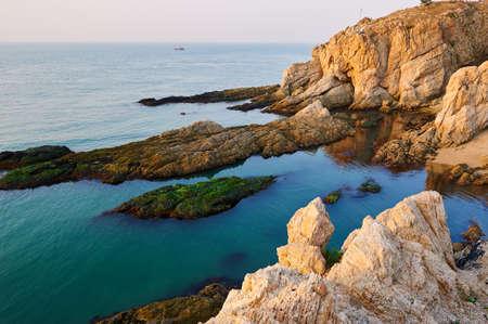 風光明媚な海岸の日の出 写真素材