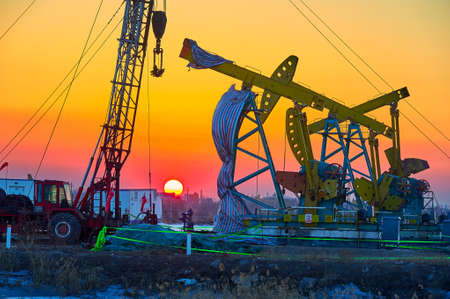 remedial: The oil derrick of oil field sunset