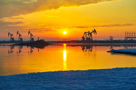 The sunrise of oil field landscape