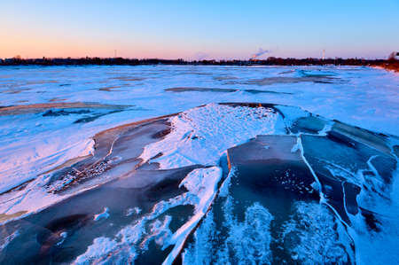 The winter lake ice and snow sunset scenic Stock Photo