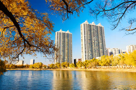 The buildings on the autumn lakeside.