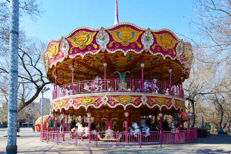 The rotating carousel in the park. Editorial