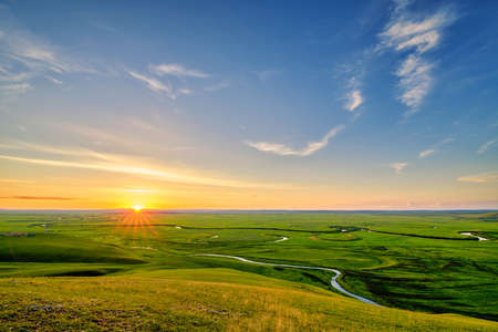 In July 2020, the Hulunbuir Prairie in Inner Mongolia, near Heishantou Town on the Sino-Russian border, is full of green grass, blue sky and white clouds, vast and high. Foto de archivo