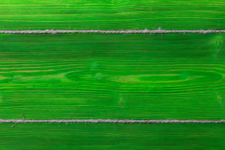 green wooden texture background with old rope
