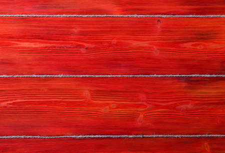 red wooden texture background with old rope Stock Photo