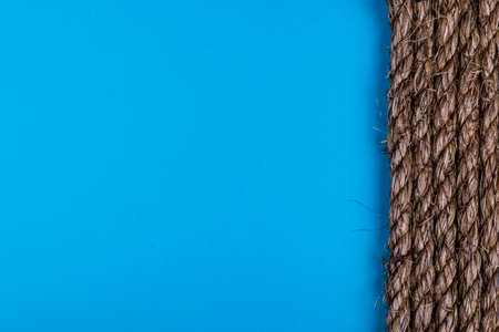natural rope: old natural rope texture on blue background Stock Photo