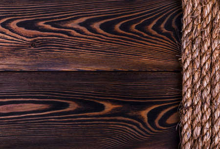 natural rope: old natural rope texture on wooden plank background