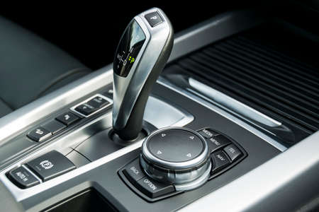 reverse: automatic gear stick of a modern car, car interior details