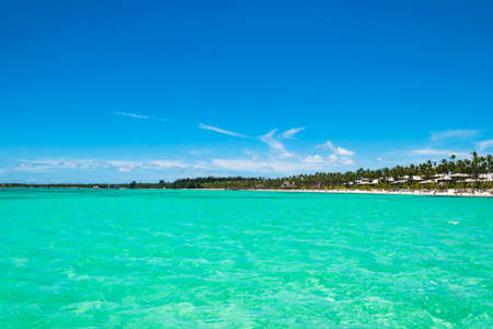 Equatorial part of the ocean with turquoise water, tropical island background Stock Photo