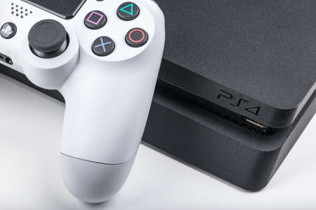 Sankt-Petersburg, Russia, May 20, 2017: Sony PlayStation 4 game console with a joystick dualshock 4 on white background,  home video game console taken in Sankt-Petersburg on May 20, 2017