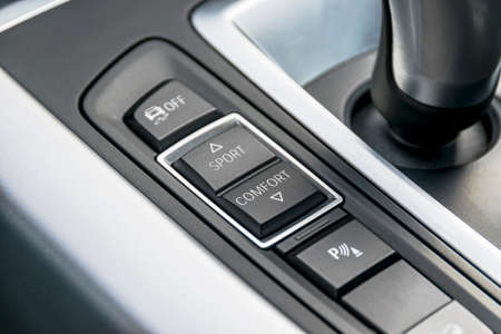 gear handle: Track control buttons near automatic gear stick of a modern car, car interior details