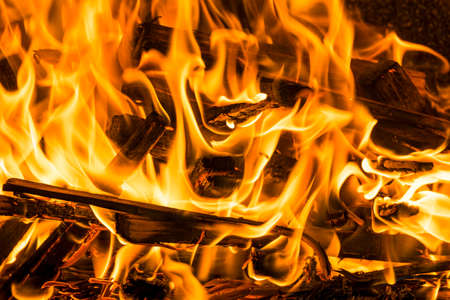 combustible: Burning firewood in the fireplace close up, BBQ fire, charcoal background Stock Photo