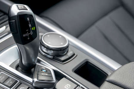 Sankt-Petersburg, Russia, May 01, 2017: Close up of keys and automatic gear stick in black leather interior, car interior details of BMW X5 2017 on the test-drive in Sankt-Petersburg at May 01, 2017