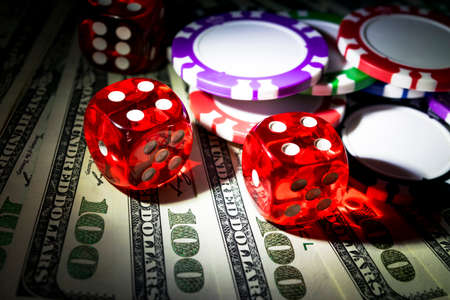 stack of dollar bill: Stack of Poker chips with dice rolls on a dollar bills, Money. Poker table at the casino. Poker game concept. Playing a game with dice. Casino dice rolls. Concept for business risk. chance good luck