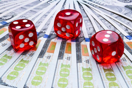 Poker dice rolls on a dollar bills, Money. Poker table at the casino. Poker game concept. Playing a game with dice. Casino dice rolls. Concept for business risk. chance good luck