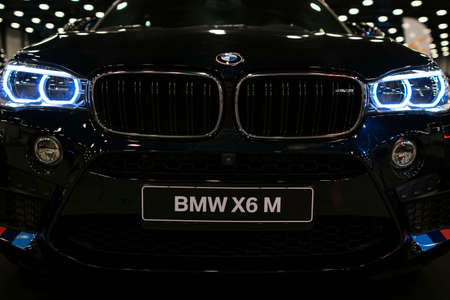 Sankt-Petersburg, Russia, July 21, 2017: BMW X6M 2017. Headlight of a modern sport car. Front view of luxury sport car. Car exterior details. Photo Taken on Royal Auto Show  July 21