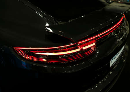 Sankt-Petersburg, Russia, July 21, 2017: Back view of a Porsche Panamera Turbo 2017. Rear Headlight .Car exterior details. Photo Taken at Royal Auto Show  July, 21 Editorial