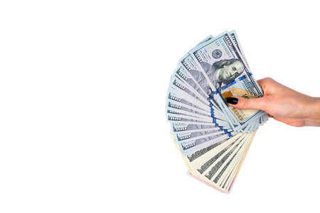 Hand with money isolated on white background. US Dollars in hand. Handful of money. Business woman offering money. Counting money. hand holds a bundle of dollar bills. Financial Credit concept.
