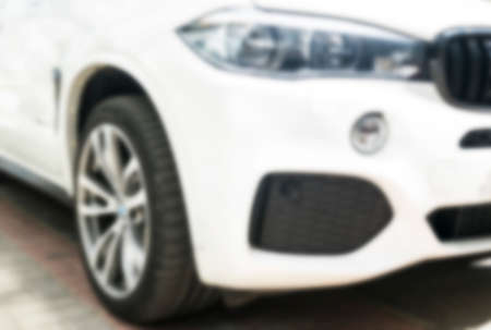 Blurred background with modern luxury white car . Car exterior details. Soft lightning