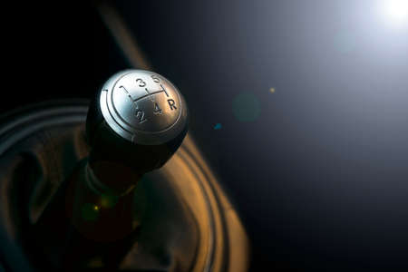 Close up view of a gear lever shift. Manual gearbox. Car interior details. Car transmission. Soft lighting. Abstract view Foto de archivo