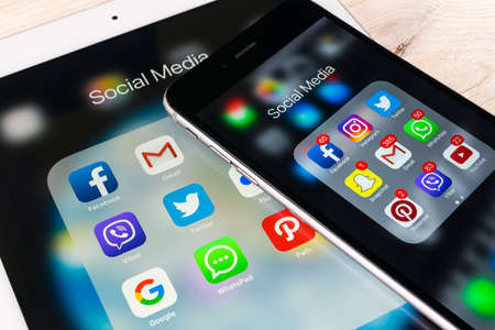 Sankt-Petersburg Russia November 13, 2017: Apple iPhone 7 and iPad pro with icons of social media facebook, instagram, twitter, snapchat application on screen. Smartphone Starting social media app.