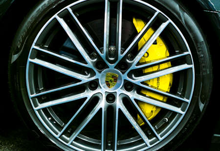 Sankt-Petersburg Russia July 21 2017: Front view of logo of Porsche on alloy wheel. Car exterior details. Photo Taken at Royal Auto Show July 21