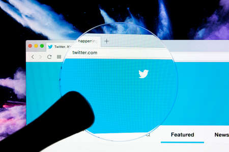 Sankt-Petersburg, Russia, December 5, 2017: Twitter login homepage Apple iMac monitor screen under magnifying glass. Twitter is a social microblogging network run by Twitter Inc.
