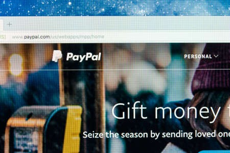 Sankt-Petersburg, Russia, December 5, 2017: Paypal website homepage on a Apple iMac monitor screen. PayPal is an international e-commerce business allowing payments and money transfers.