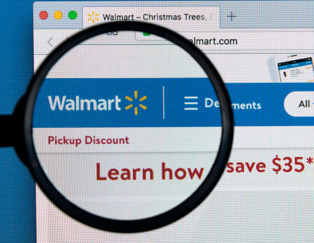 Sankt-Petersburg Russia December 7, 2017: Walmart homepage website on Apple iMac monitor screen under magnifying glass. Walmart is an American multinational retailing corporation.