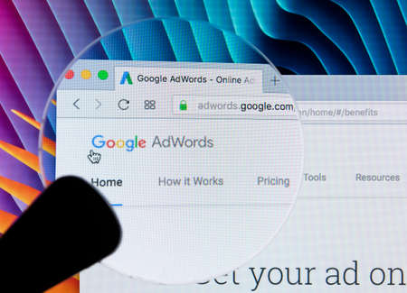 Sankt-Petersburg Russia December 7, 2017: Google Adwords homepage website on Apple iMac monitor screen under magnifying glass. Google AdWords is online advertising service. Editorial