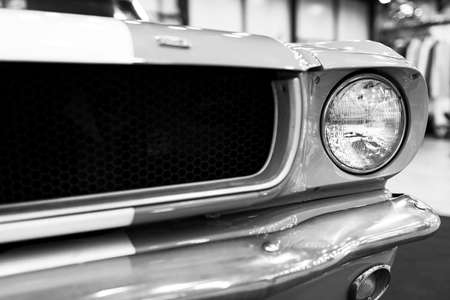 Sankt-Petersburg, Russia, July 21, 2017: Front view of Classic retro Ford Mustang GT.Car exterior details. Headlight of a retro car. Black and white. Photo Taken on Royal Auto Show  July, 21 Editorial