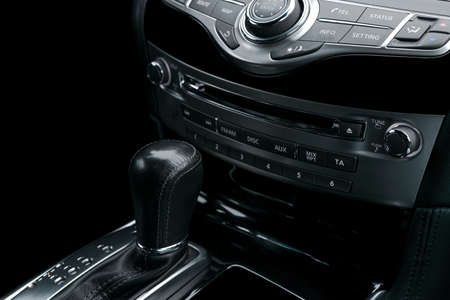 Luxury car inside. Interior of prestige modern car. Automatic transmission gear shift.