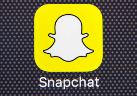 Sankt-Petersburg, Russia, January 25, 2018: Snapchat application icon on Apple iPhone 8 smartphone screen close-up. Snapchat app icon. Snapchat is an online social networking service .