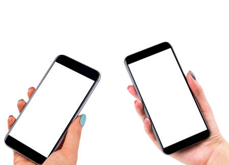 Beautiful Woman hands holding two smart phone with isolated white screen. Business workplace with copy space. Empty space for text. Isolated screen for mock up. Left and right hand Stock Photo