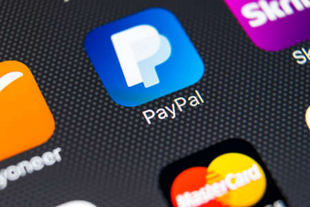 Sankt-Petersburg, Russia, February 8, 2018: PayPal application icon on Apple iPhone 8 smartphone screen close-up. PayPal app icon. PayPal is an online electronic payment system . Editorial