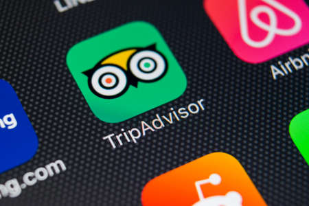 Sankt-Petersburg, Russia, February 9, 2018: Tripadvisor application icon on Apple iPhone X screen close-up. Tripadvisor.com app icon. Tripadvisor is an online travel website. social media network. Social media app